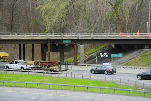 A view of the Sitterly Road bridge overpass on Thursday, April 15, 2021, in Clifton Park, N.Y. The bridge was struck on Wednesday causing damage to some of the beams, which resulted in all three southbound lanes of the Northway being closed to traffic. Supports have been installed under the bridge and the left and center lanes of the Northway  have been reopened. The right lane remains closed and the Northway southbound on-ramp at Exit 9 is also closed.   (Paul Buckowski/Times Union)