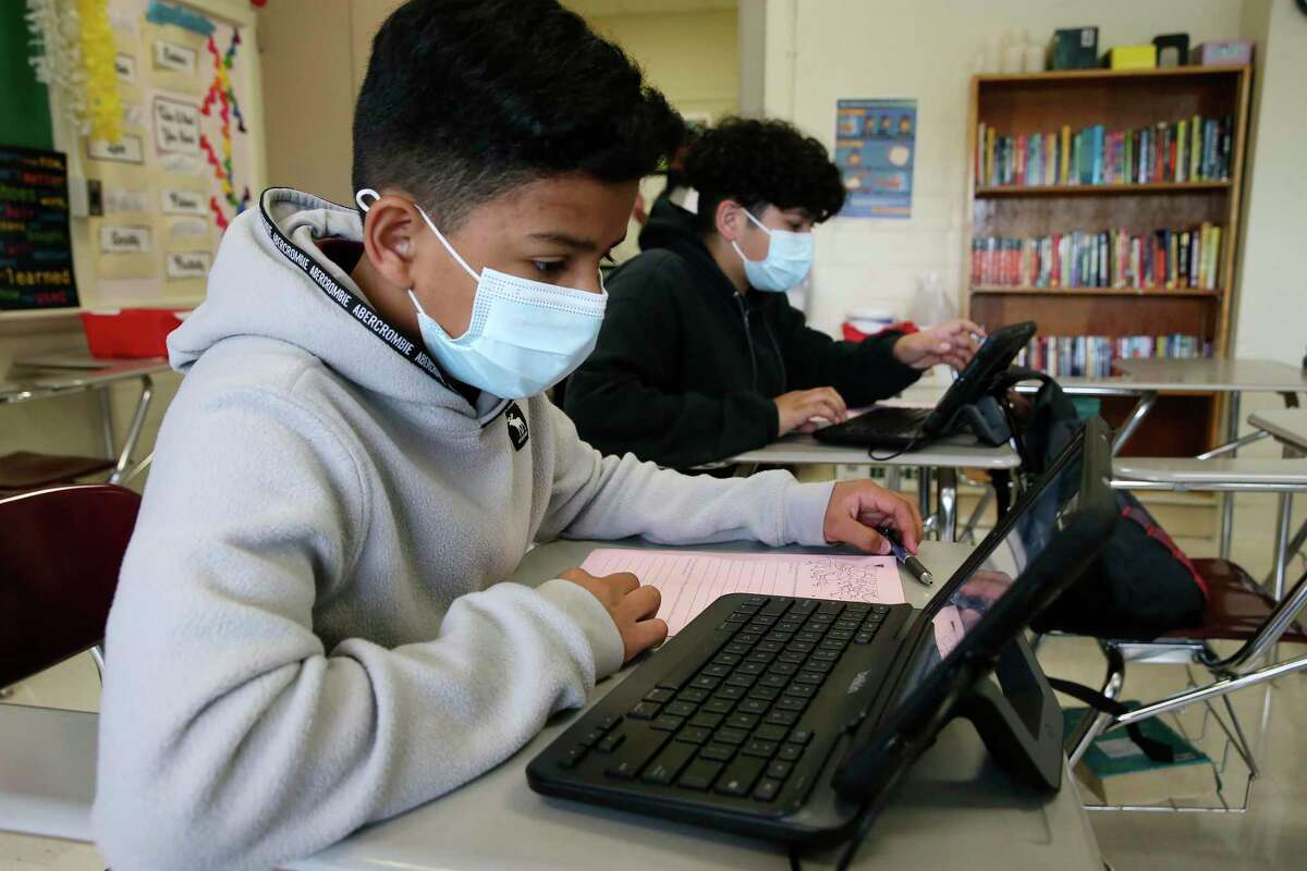 Noah Urbina, 13, logs into a program at the start of a 7th grade writing class at Rhodes Middle School in April. This year's STAAR results show that more students have struggled to meet educational standards during the pandemic.