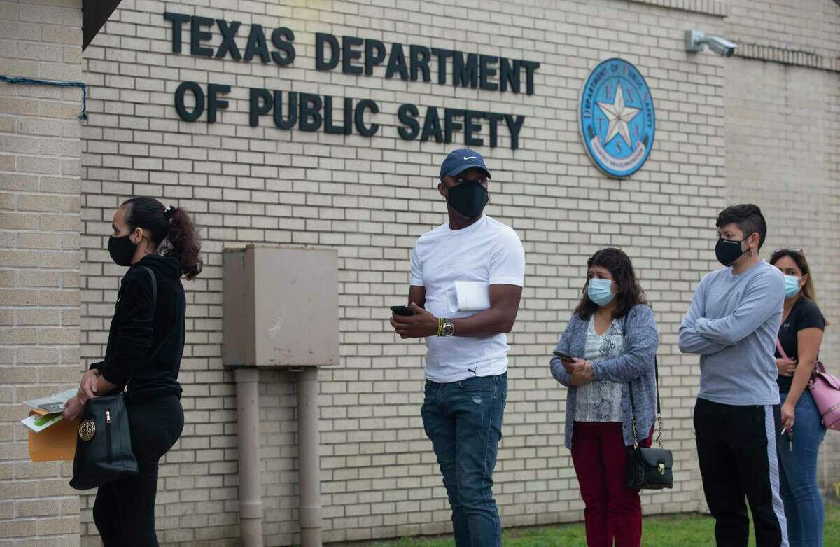 People wait in line outside the Texas Department of Public Safety Driver License on Dacoma Street Thursday, April 15, 2021, in Houston.