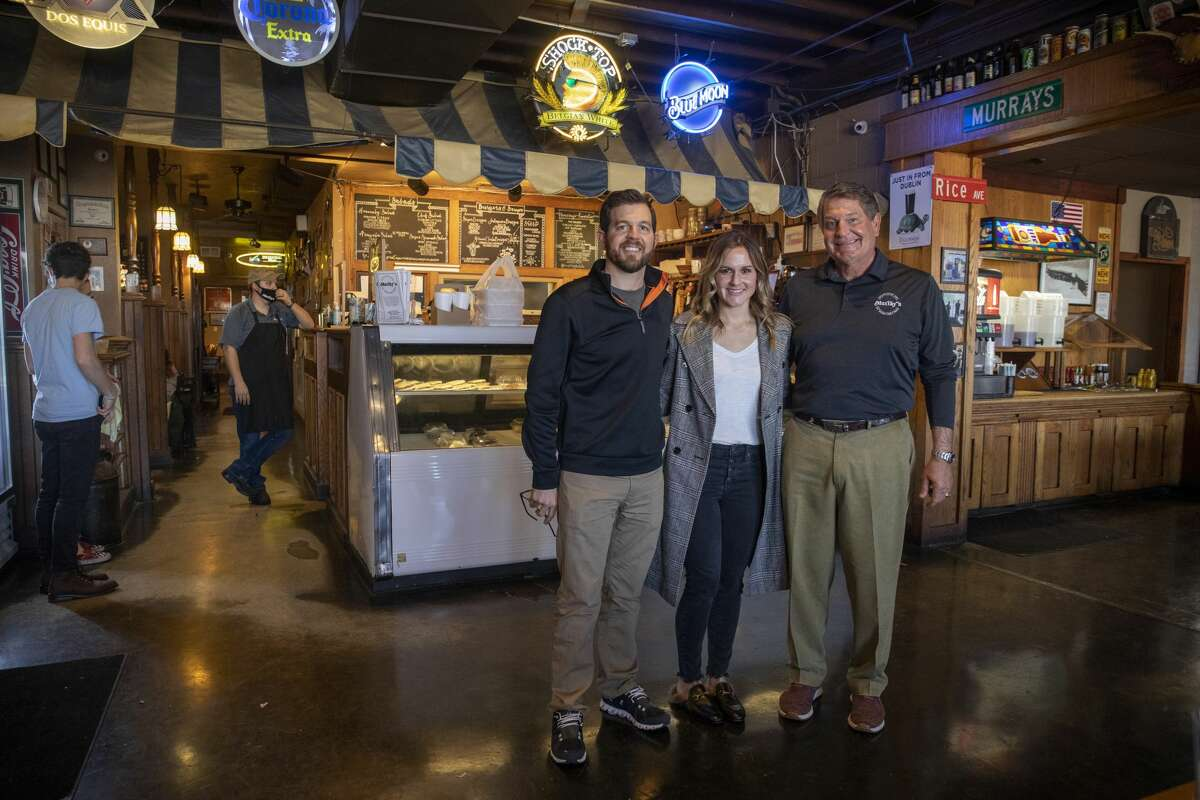Owners Neil Dufford, Betsy Wells and Scott Dufford pose for a portrait January 14 at Murray's Deli in Midland.