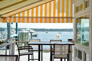 The outdoor deck at Carlson's Landing at the Essex Boat Works and Marina.