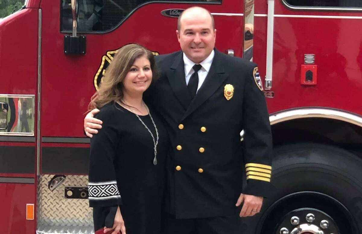 Newly appointed Katy Fire Department Chief Kenneth Parker poses with his wife after taking the oath of office on April 12, 2021.