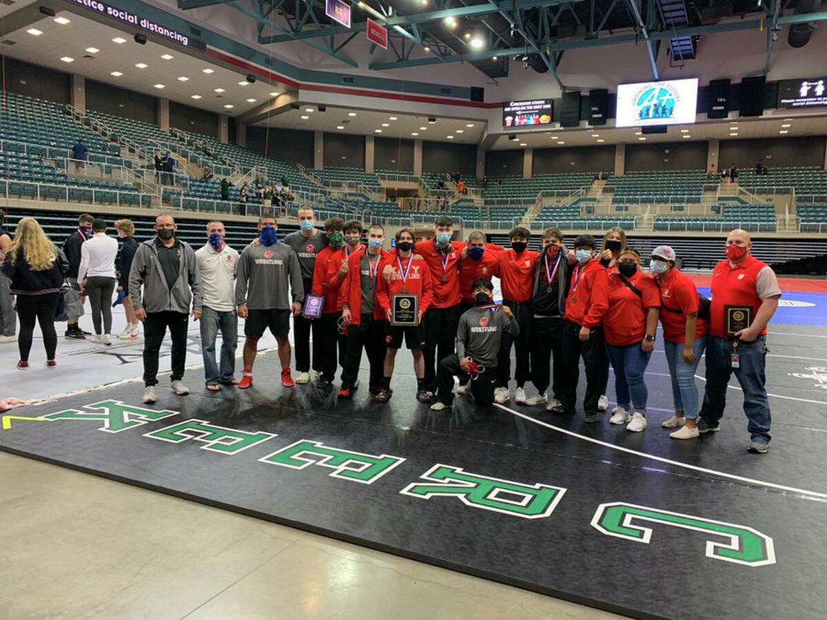 The Katy boys wrestling team won the District 9-6A championship, scoring 170.5 points to finish ahead of Seven Lakes (170) and Strake Jesuit (144).