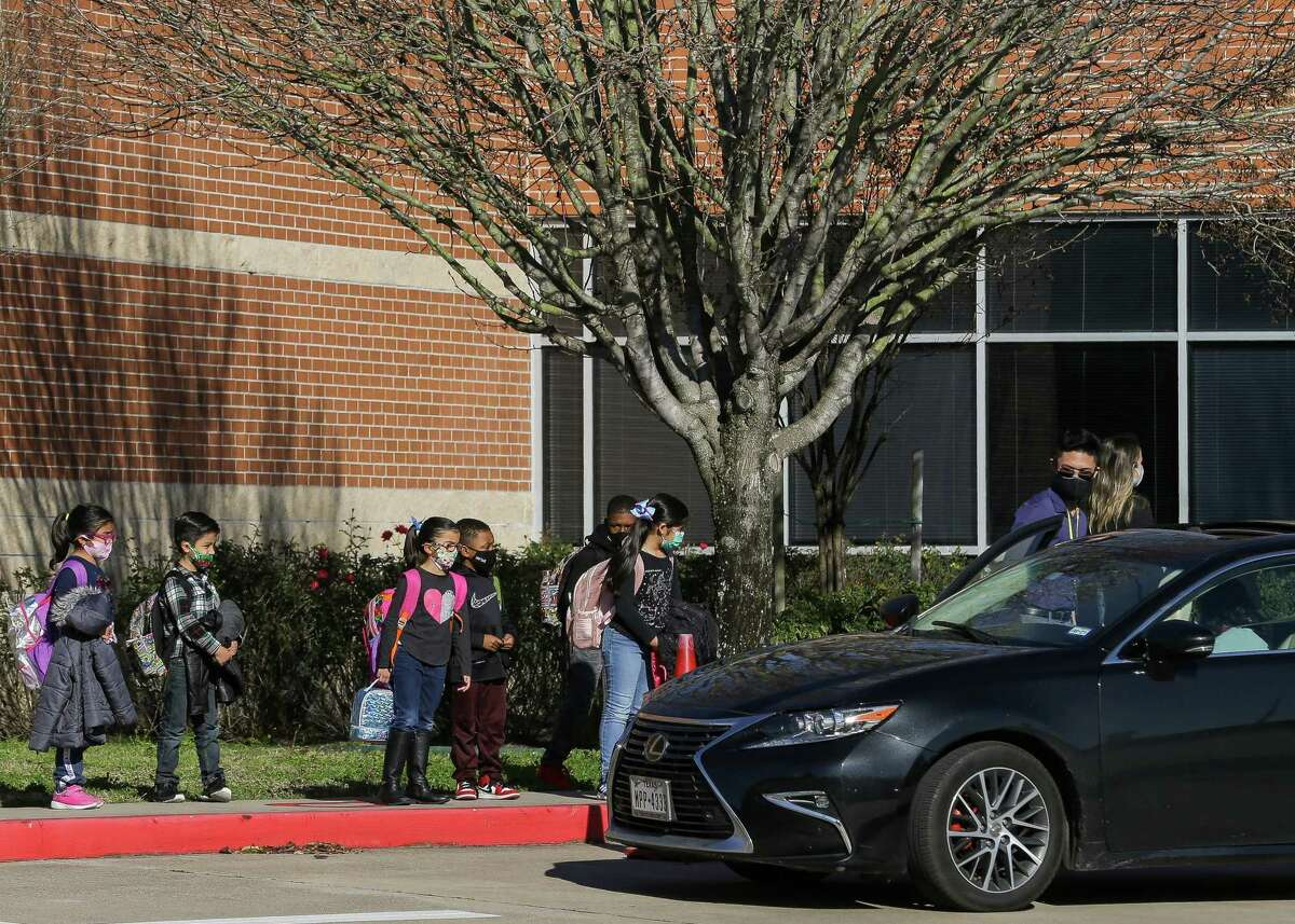 Juan Seguin Elementary School in Richmond was forced to transition to online learning due to the COVID-19 pandemic on Tuesday, Feb. 2. The campus is now open with no current reported cases of the coronavirus. Students are shown here waiting to be picked up after school on Monday, Feb. 1.