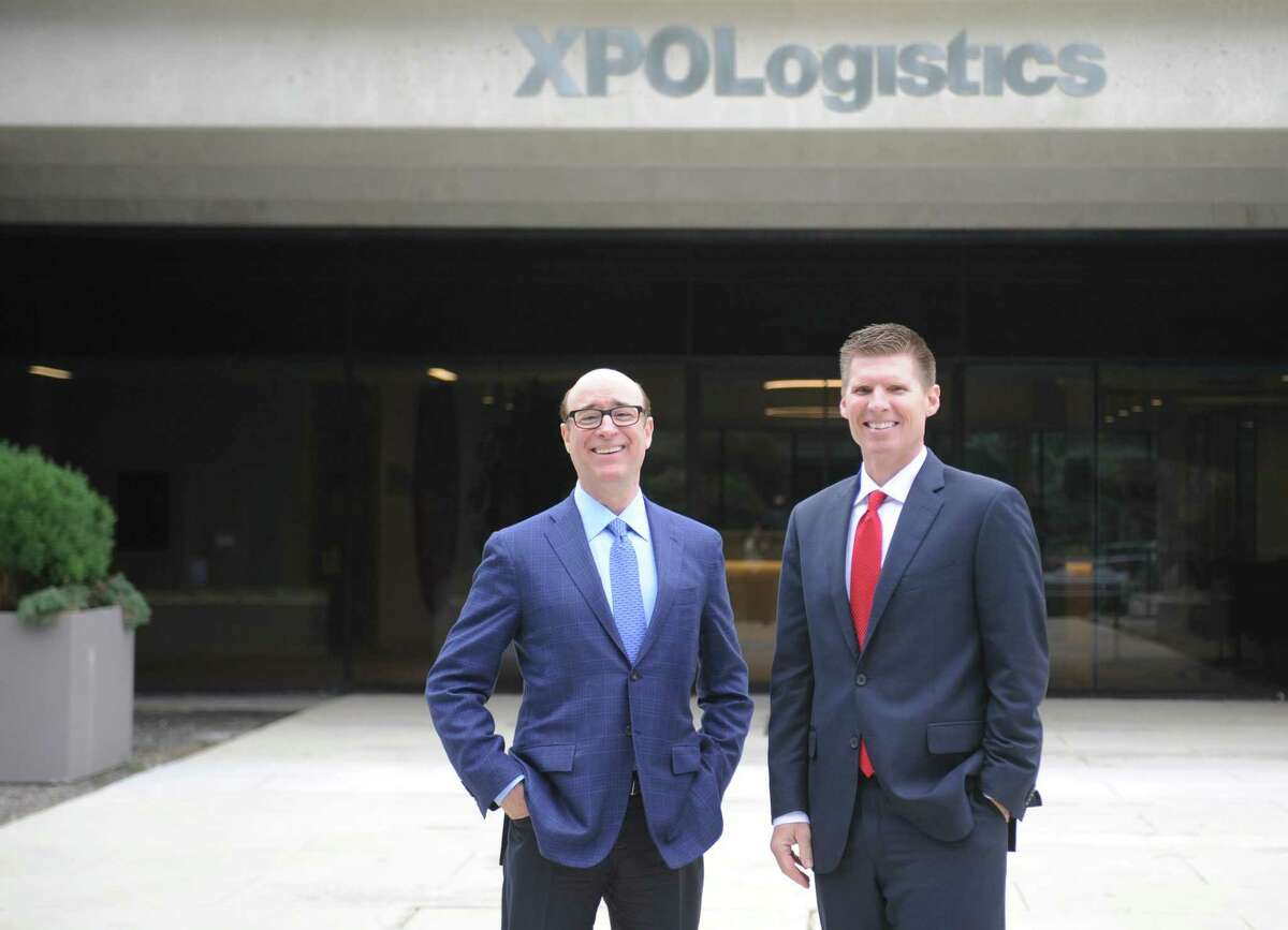 XPO Logistics CEO and Chairman Bradley Jacobs, left, and President Troy Cooper stand outside the company's headquarters at 5 American Lane in Greenwich, Conn., on July 25, 2017.