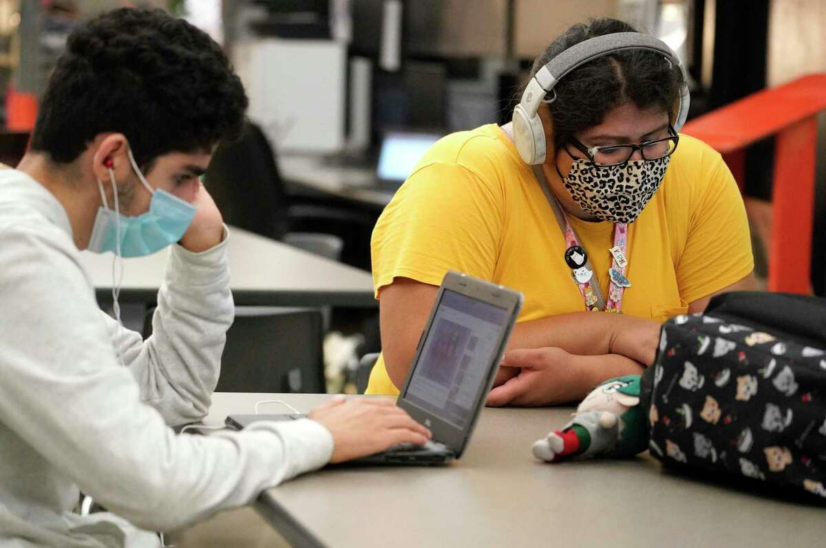Ramzy Goodside, 16, a sophomore, left, and Cassandra Moctezuma, 18, a senior, right, are shown in journalism class at Stratford High School. Spring Branch ISD has had a mask requirement throughout the entire 2020-2021 school year, but it announced its expectation that there would be no mask requirement when the 2021-2022 school year starts on Aug. 16.