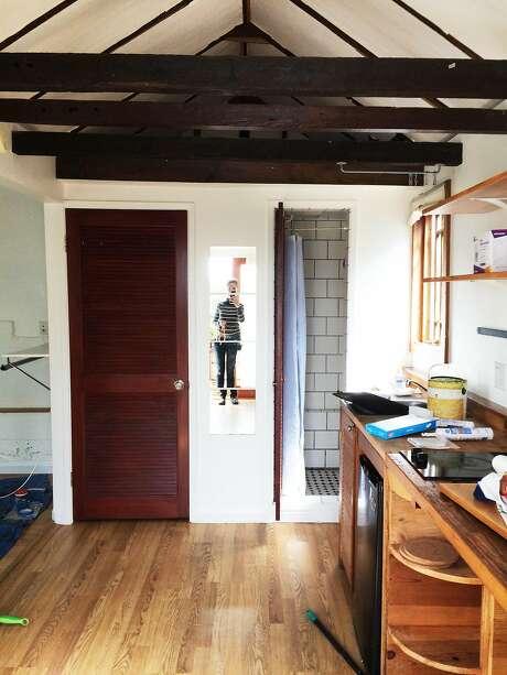 LisaRuth Elliott takes a photo inside the Bernal Heights home where she used to live, which was a modified 1906 earthquake shack. Photo: Courtesy LisaRuth Elliott