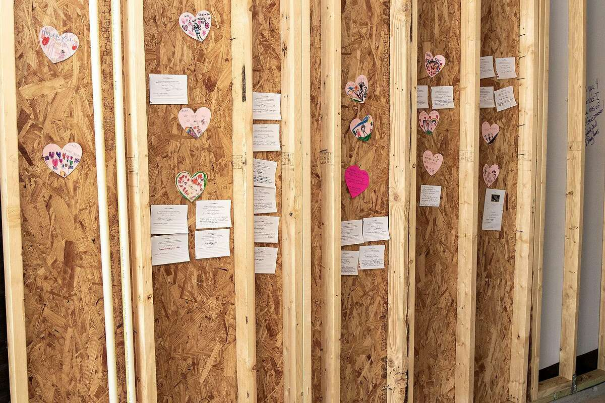 Some of the plywood has notes of love stapled to it providing inspiration and encouragement to Staff Sgt. Stephen Netzley and his daughter Mrazy.