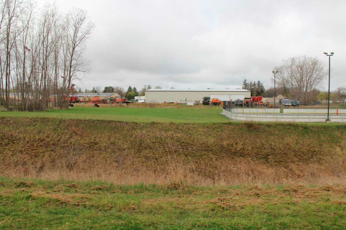The view from along the eastern edge of the Bad Axe walking path. A planned tree planting program would have trees grow along this side and provide a visual barrier. (Robert Creenan/Huron Daily Tribune)