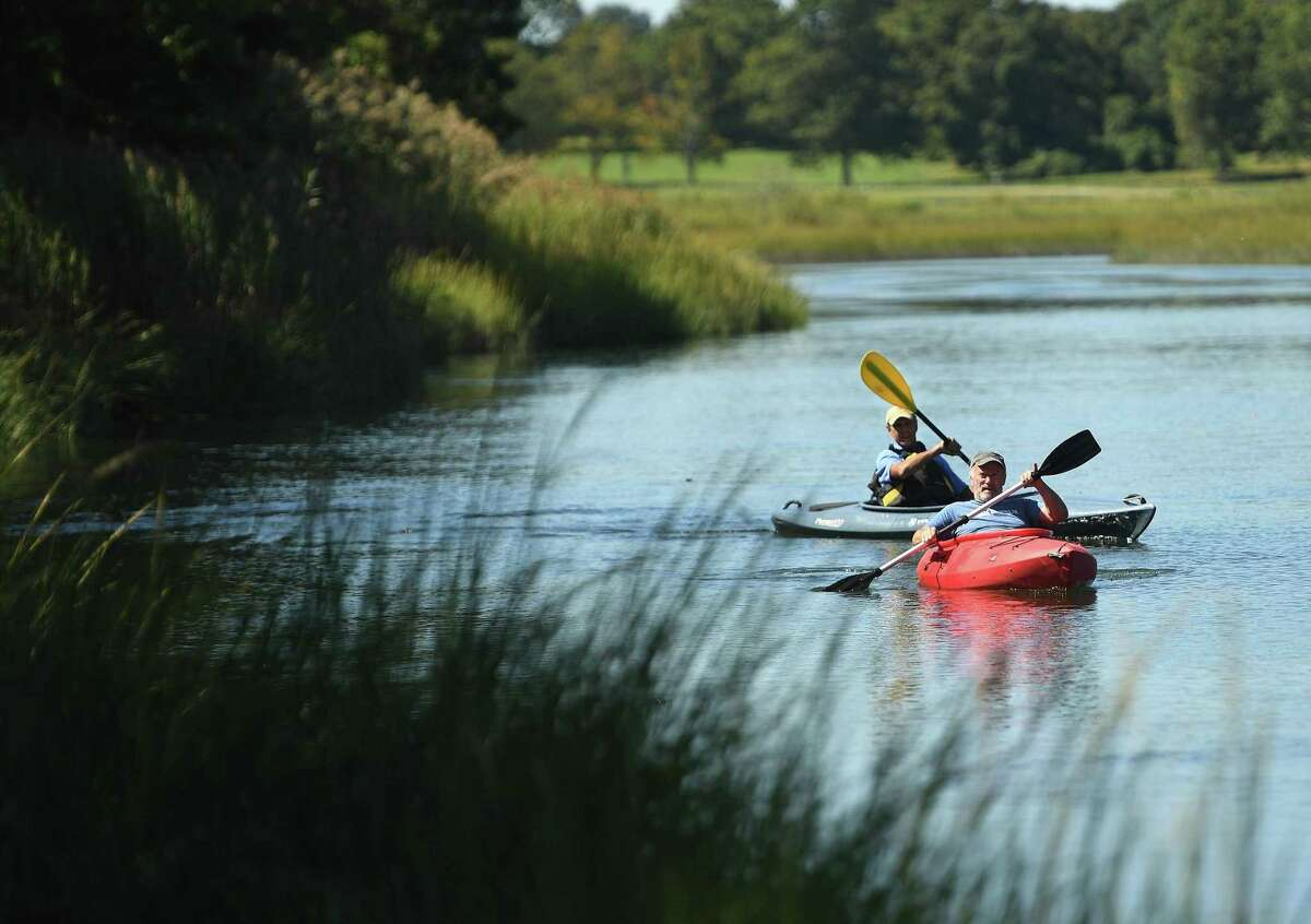 Friends Gary Nichols, left, and David Thornton, both of Fairfield, kayak on scenic Mill Creek in Westport, Conn. on Tuesday, September 17, 2019. Mill Creek forms the border of Sherwood Island State Park.