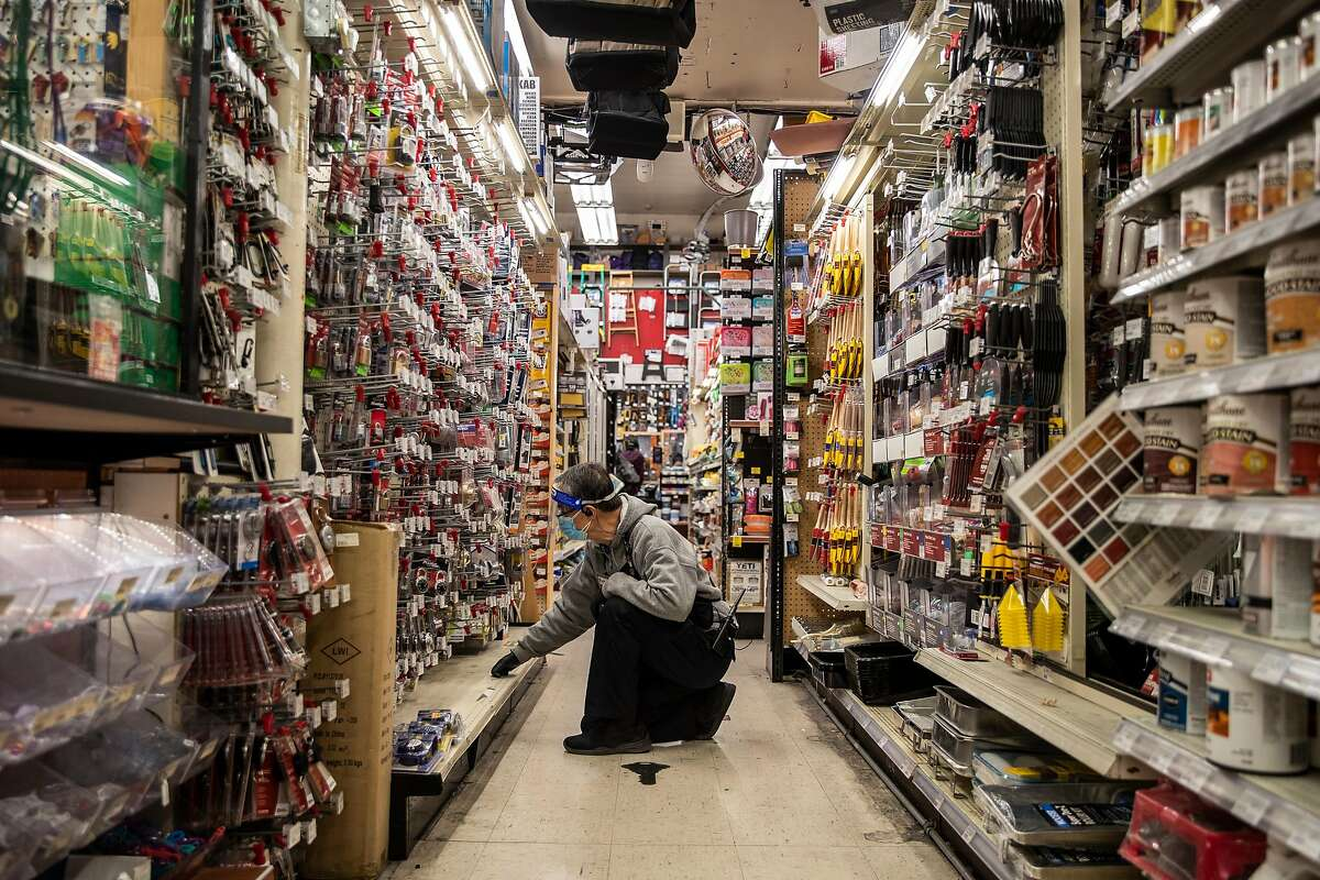 Master locksmith Frank Yee searches for an item at Cole Hardware in downtown San Francisco.