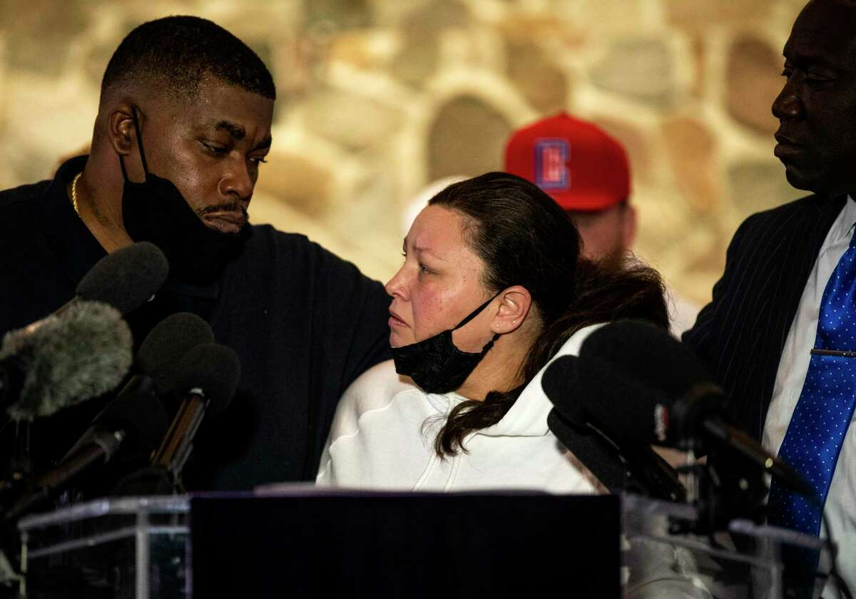 Daunte Wright's parents, Aubrey and Katie Wright, embrace during a Thursday press conference in Minneapolis. A police officer has been charged with manslaughter in the Sunday shooting.