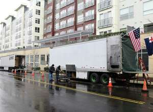 """Large trucks line the street where """"The Good Nurse"""" is being filmed in Stamford, Conn. Thursday, April 15, 2021. The upcoming Netflix true crime film stars Eddie Redmayne playing Charles Cullen, who murdered anywhere between 40 and 300 patients while working in critical care units across New Jersey and Pennsylvania. Cullen's coworker and friend, played by Jessica Chastain, eventually helped take him down. The movie is being filmed in the medical building at 90 Morgan Street until Friday, where it will then migrate to a residential block in the Waterside neighborhood of Stamford."""