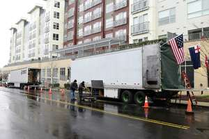 "Large trucks line the street where ""The Good Nurse"" is being filmed in Stamford, Conn. Thursday, April 15, 2021. The upcoming Netflix true crime film stars Eddie Redmayne playing Charles Cullen, who murdered anywhere between 40 and 300 patients while working in critical care units across New Jersey and Pennsylvania. Cullen's coworker and friend, played by Jessica Chastain, eventually helped take him down. The movie is being filmed in the medical building at 90 Morgan Street until Friday, where it will then migrate to a residential block in the Waterside neighborhood of Stamford."