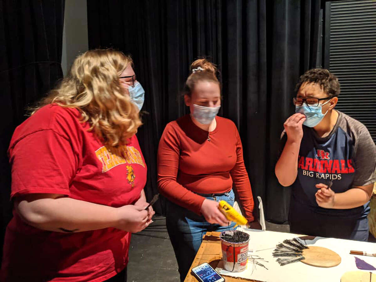 In this photo, Big Rapids high schoolers work hard with props for the middle school's production of Mary Poppins Jr. The high school drama students will make their return to a live stage next month for the first time since the COVID-19 pandemic began