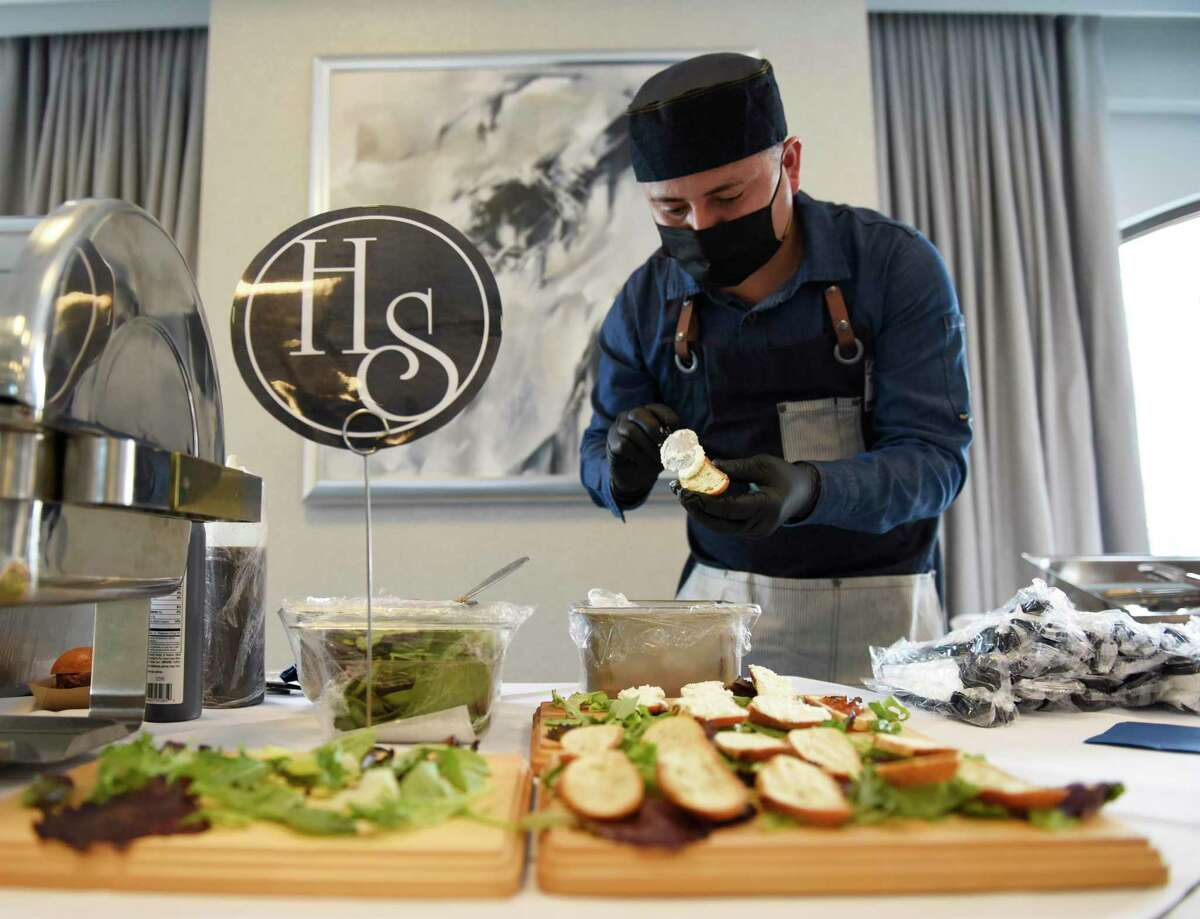 Hudson Social chef Neftali Gonzalez makes tomato jam crostini at the