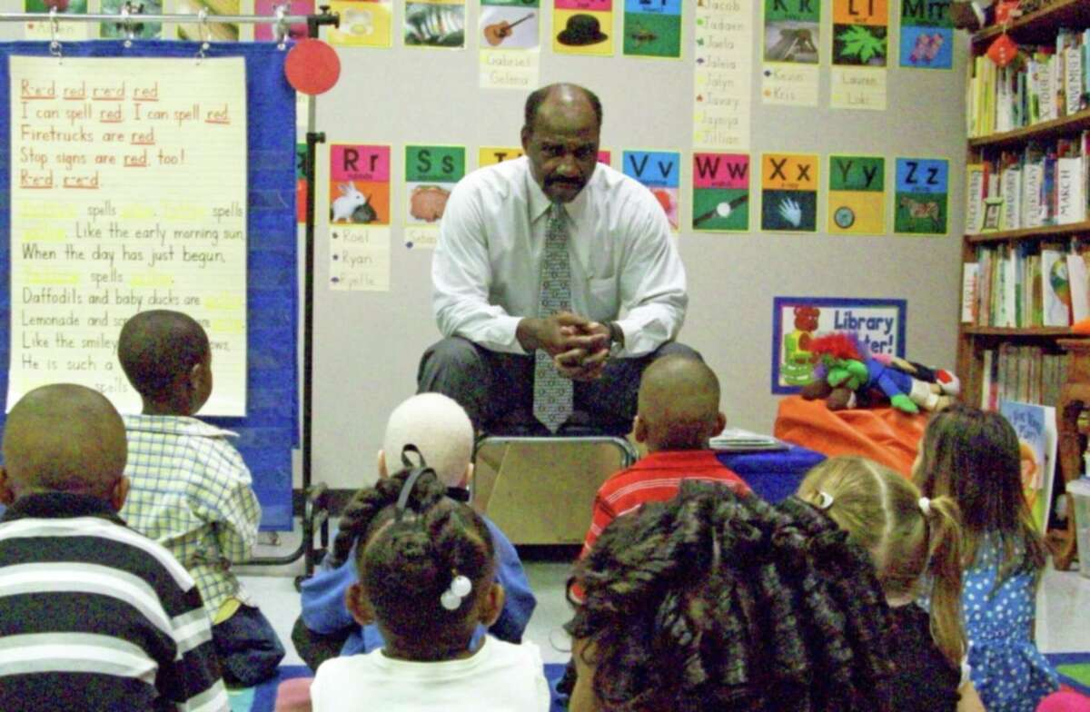 Conroe Independent School District board member Gerald Irons recently visited Reaves Elementary and shared a story with Nan Carpenter's pre-kindergarten class.