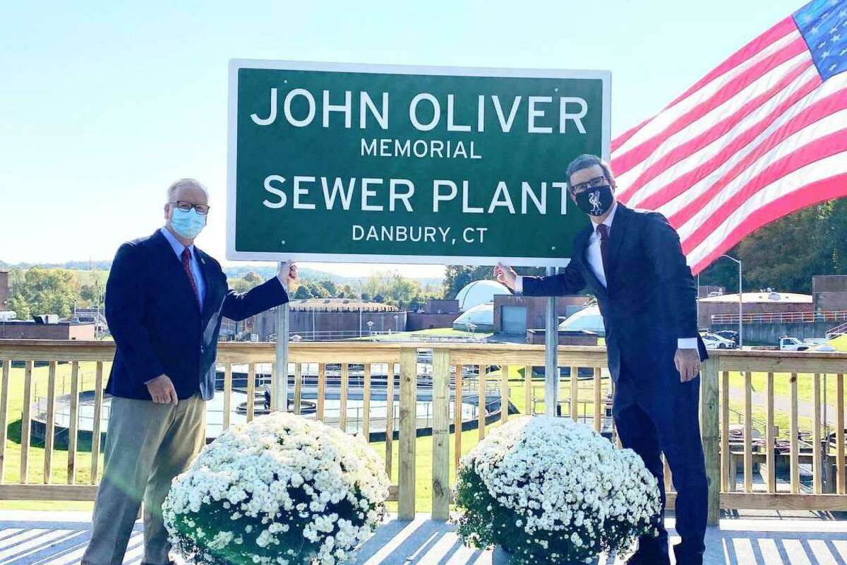 """Former Danbury Mayor Mark Boughton, left, and comedian John Oliver at a ribbon cutting in October, 2020 for the """"John Oliver Sewer Plant."""""""