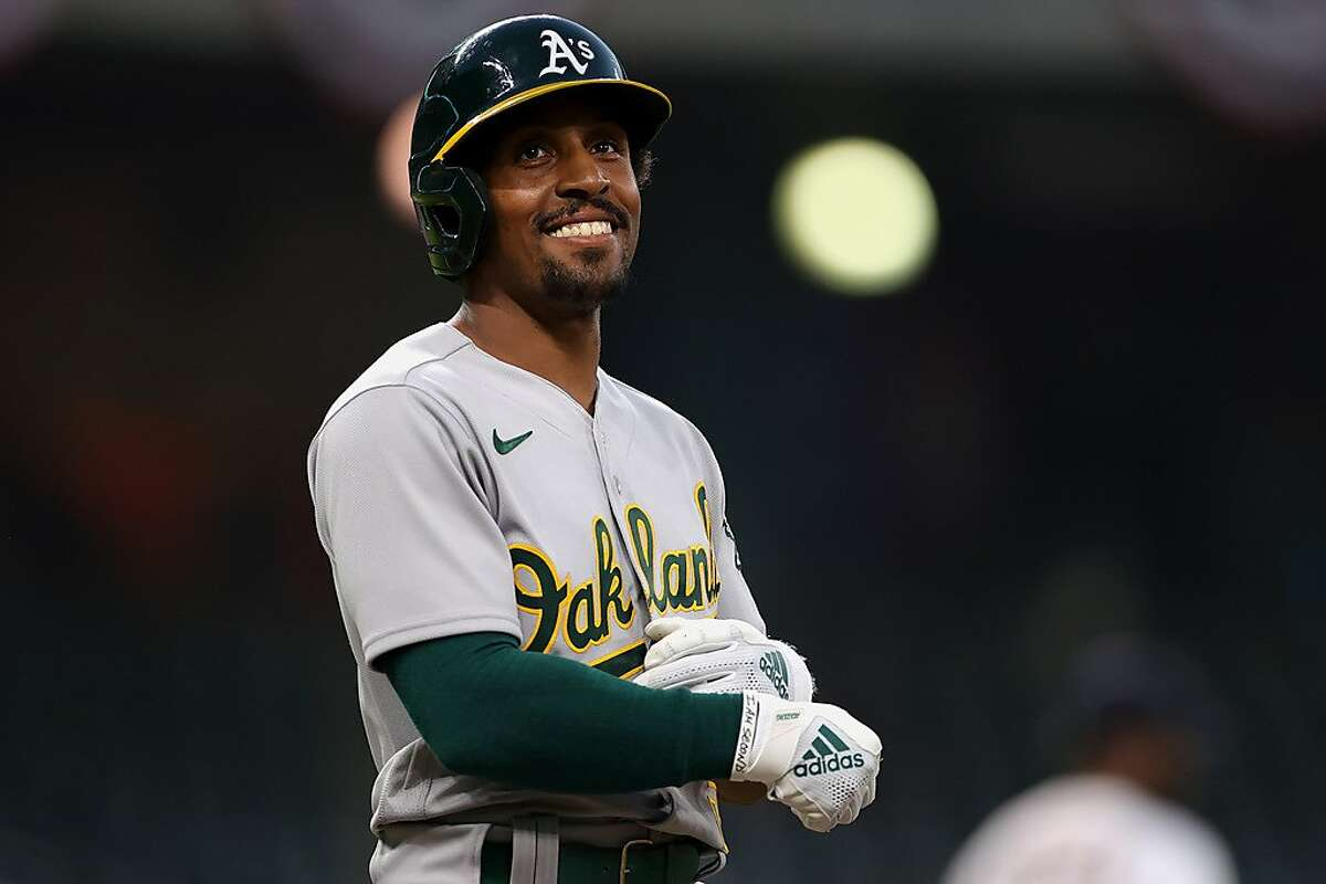 HOUSTON, TEXAS - APRIL 08: Tony Kemp #5 of the Oakland Athletics looks on after walking during the third inning against the Houston Astros at Minute Maid Park on April 08, 2021 in Houston, Texas. (Photo by Carmen Mandato/Getty Images)