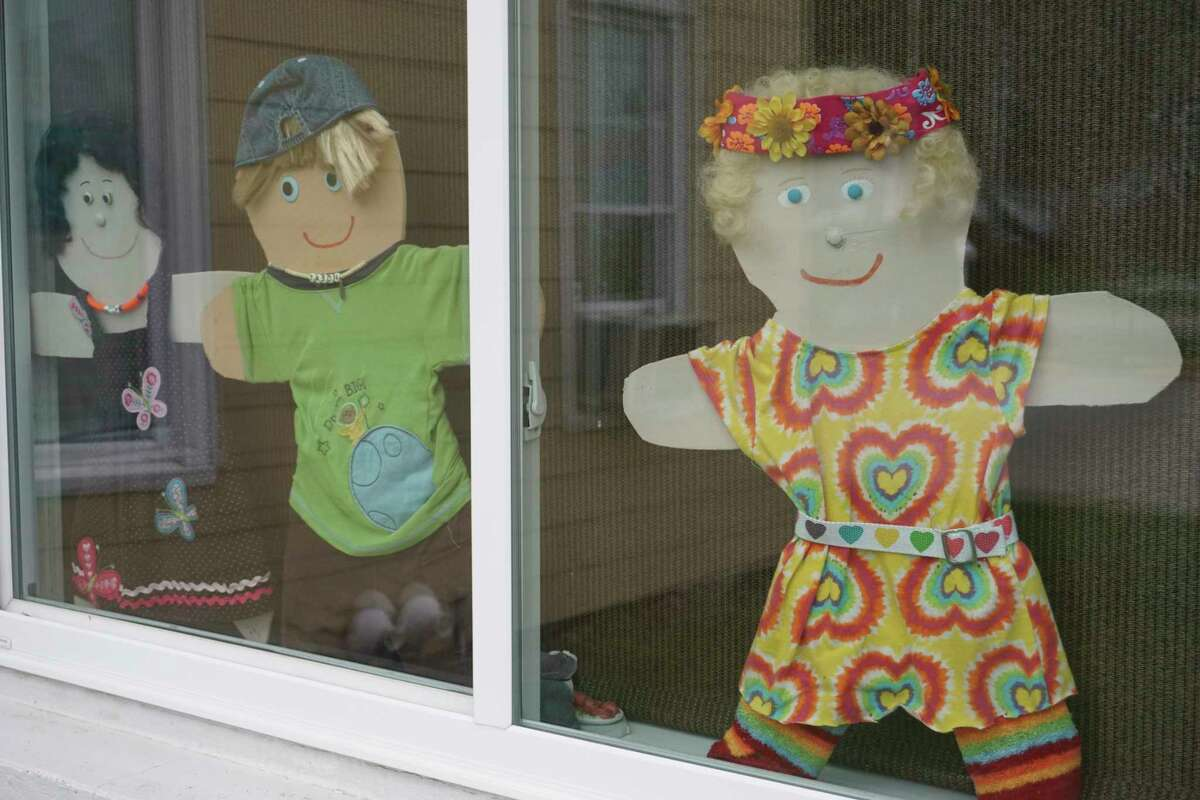 Each of Panek's dolls represent various aspects of her personality and showcased on the windows of Ala Mode Restaurant in Big Rapids. (Pioneer photo/Joe Judd)