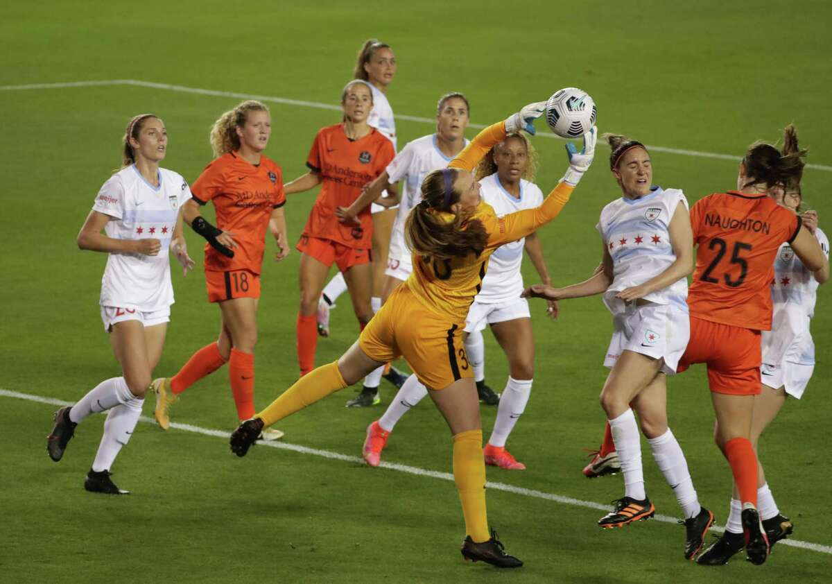 Chicago goalkeeper Cassie Miller grabs the ball during the first half of a 2021 NWSL Challenge Cup presented by Secret Deodorant at BBVA Compass Stadium on Friday, April 9, 2021, in Houston.