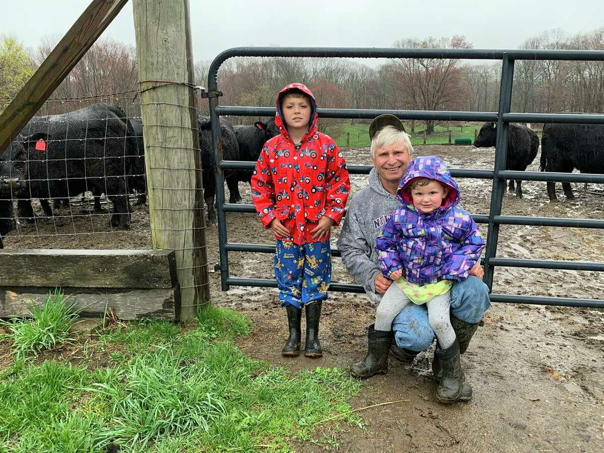 Ron Rice and his grandchildren, Cody and Riley Pleil. Rice owns Sleepy Hollow Farm, where Buddy was captured.