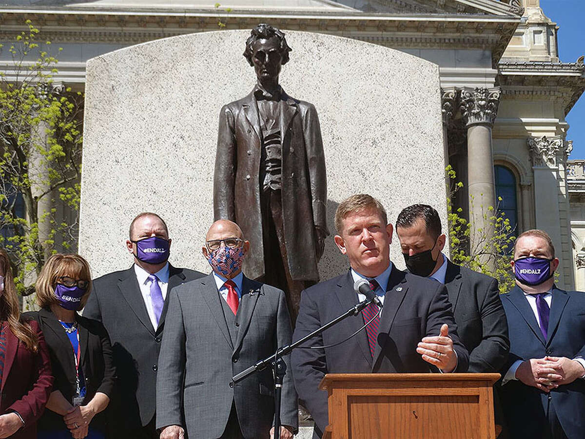 Illinois State Police Director Brendan Kelly joins a bipartisan group of lawmakers during a news conference outside the Statehouse to promote legislation that would modernize the state'€™s system for issuing Firearms Owners Identification cards and Concealed Carry Licenses.