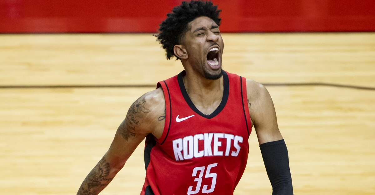 Houston Rockets center Christian Wood (35) reacts after making a dunk during the fourth quarter of the Houston Rockets 102-93 win over the Dallas Mavericks on Wednesday, April 7, 2021, at Toyota Center in Houston.