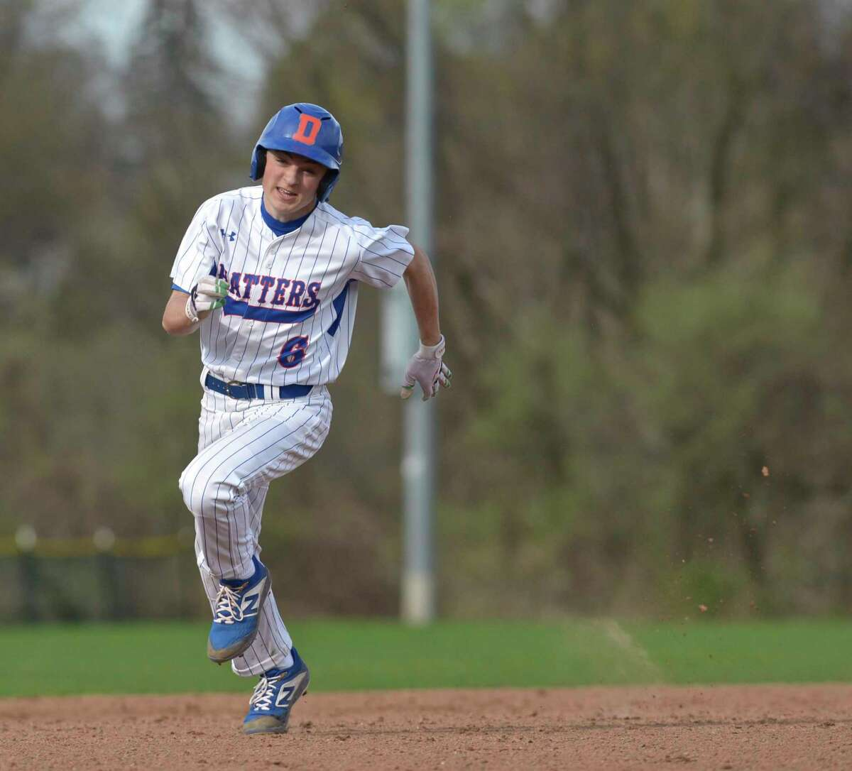 Danbury'' Jackson Ciccone rounds second on his way home to score against St. Joseph in 2019.