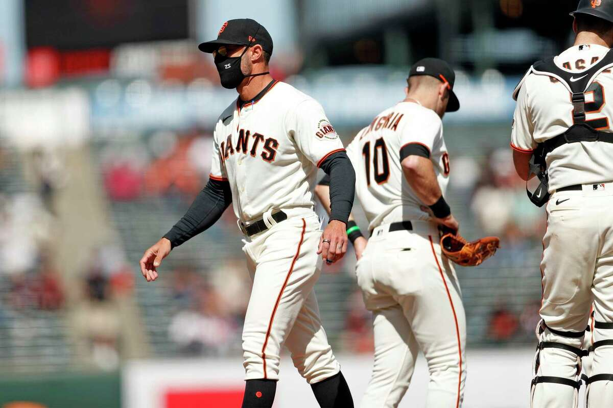 San Francisco Giants' manager Gabe Kapler heads back to the dugout after making a pitching change in 7th inning against Colorado Rockies during MLB game at Oracle Park in San Francisco, Calif., on Sunday, April 11, 2021.