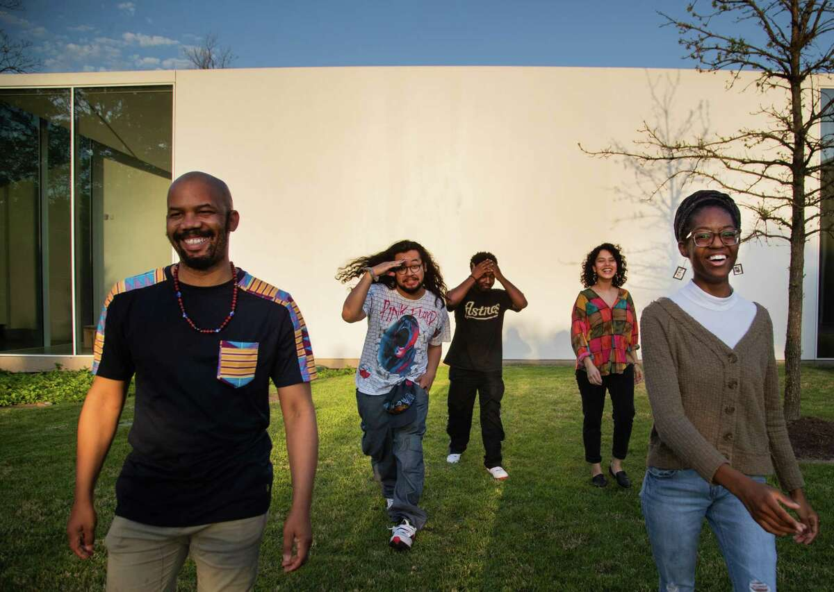 (Left to right) Writers in the Schools' poetry slam team members Outspoken Bean, 34, Muhammad Khaerisman, 23, Calvin King, 21, Adriana Salazar, 22, and Aris Brown, 23, at the Menil Drawing Institute, Monday, April 5, 2021, in Houston.