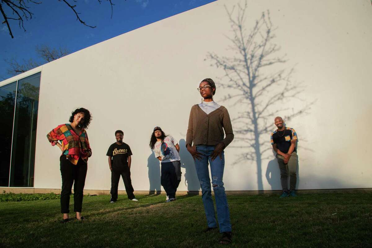 (Left to right) Writers in the Schools' poetry slam team members Adriana Salazar, 22, Calvin King, 21, Muhammad Khaerisman, 23, Aris Brown, 23, and Outspoken Bean, 34, at the Menil Drawing Institute, Monday, April 5, 2021, in Houston.