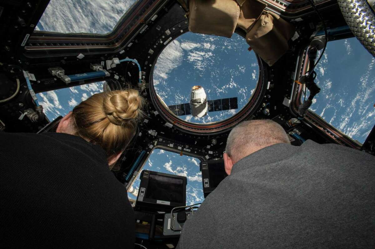 NASA astronauts Kate Rubins (left) and Jeff Williams (right) prepare to grapple the SpaceX Dragon supply spacecraft from aboard the International Space Station. Rubins, a native of Napa, and her crew mates will return to earth Friday.