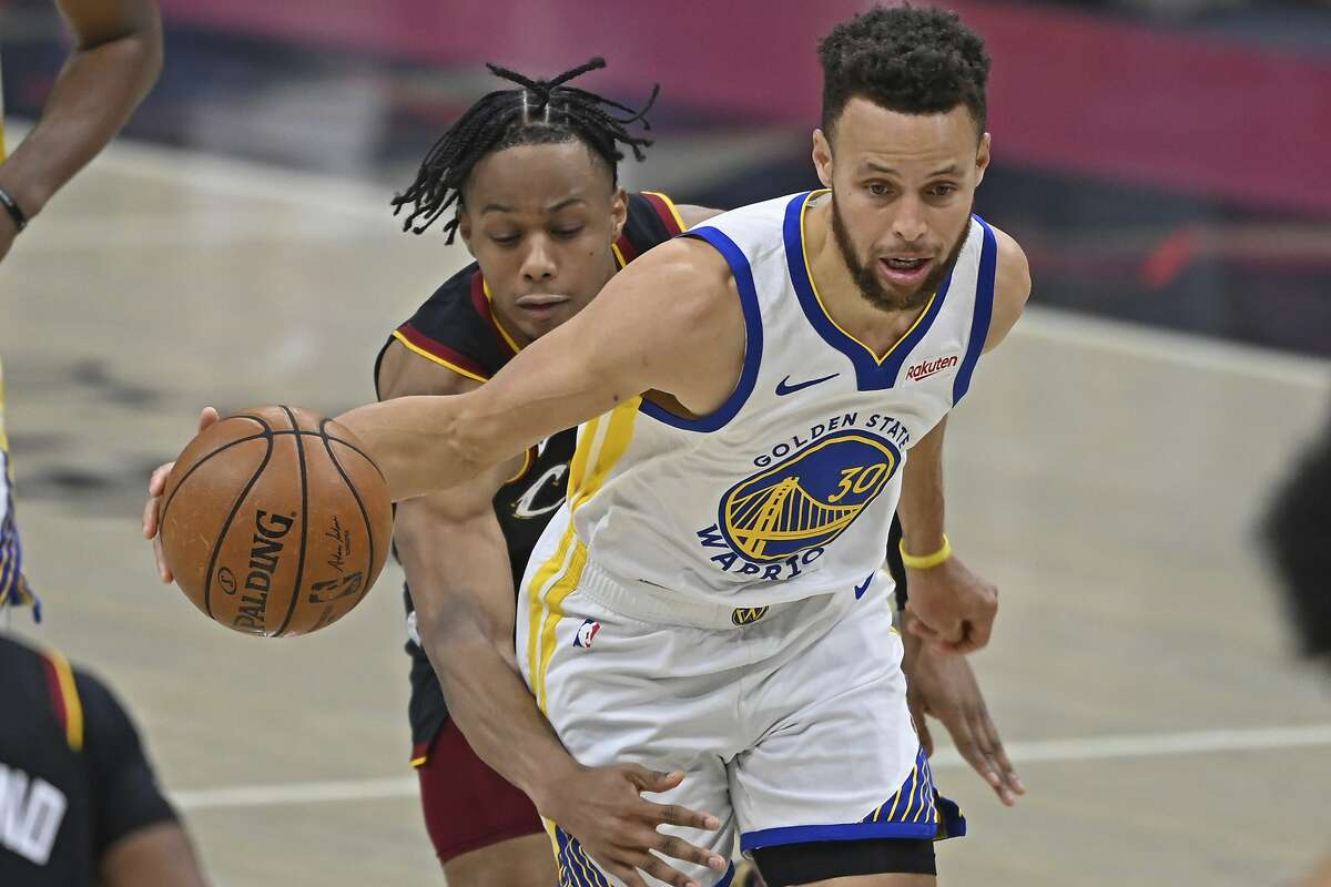 Golden State Warriors' Stephen Curry (30) drives against Cleveland Cavaliers' Isaac Okoro in the second half of an NBA basketball game, Thursday, April 15, 2021, in Cleveland. (AP Photo/David Dermer)