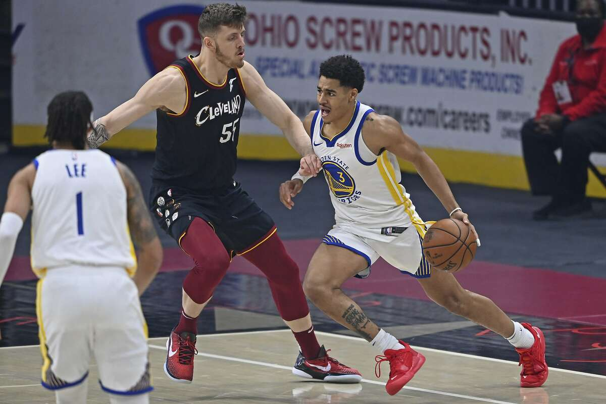Golden State Warriors' Jordan Poole (3) drives on Cleveland Cavaliers Isaiah Hartenstein (55) in the first half of an NBA basketball game, Thursday, April 15, 2021, in Cleveland. (AP Photo/David Dermer)