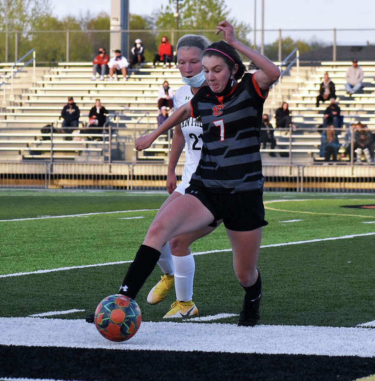 Edwardsville's Jadyn Renth, front, battles for possession at midfield during the first half of Thursday's game against O'Fallon inside the District 7 Sports Complex.