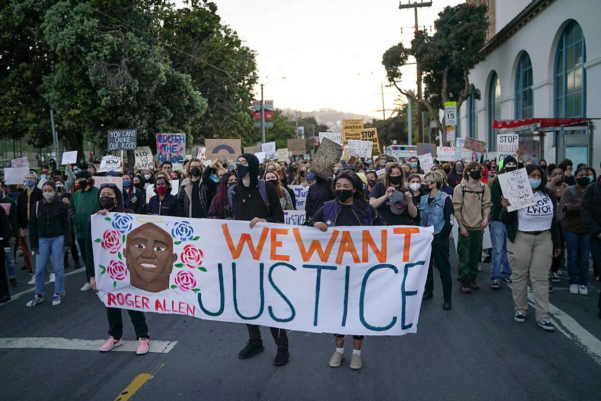 Demonstrators march outside San Francisco's Mission High School to protest the killings of Roger Allen in S.F. by a Daly City officer and Daunte Wright by police in Minnesota.