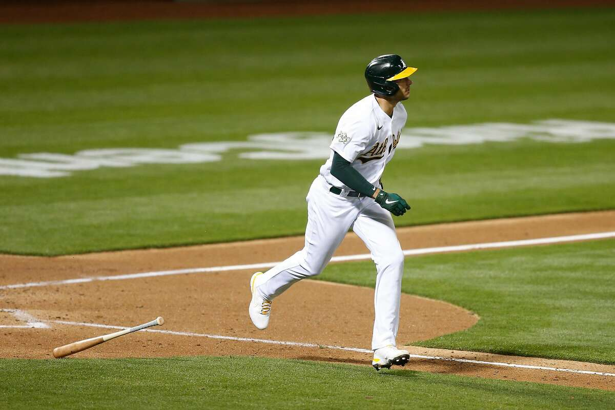 Matt Olson of the A's hits a solo home run in the bottom of the fifth inning against the Tigers.