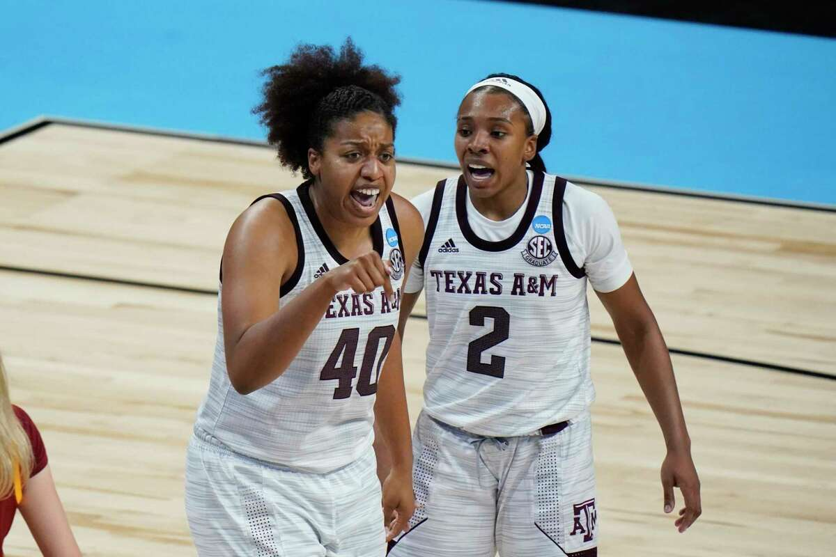 Texas A&M center Ciera Johnson (40) reacts with teammate Aaliyah Wilson (2) during the second half of a college basketball game against Iowa State in the second round of the women's NCAA tournament at the Alamodome in San Antonio, Wednesday, March 24, 2021. (AP Photo/Eric Gay)