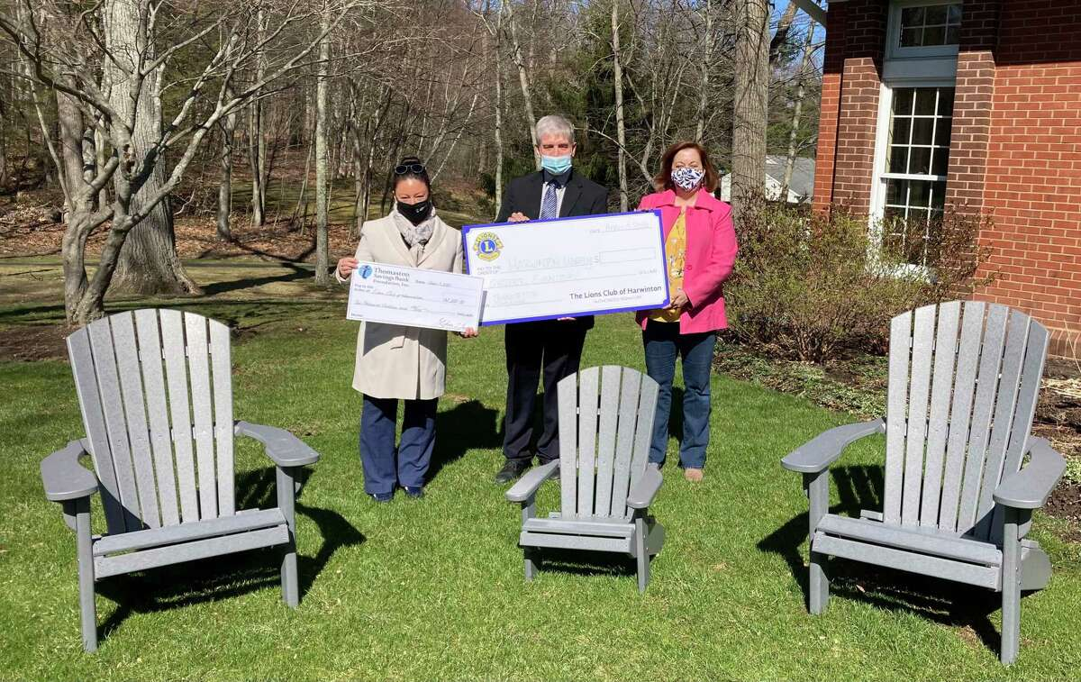 Some of the Harwinton Library's new outdoor furniture with, from left, Cheryl Lindstrom, community outreach officer at Thomaston Savings Bank; Eric Van Leer, Harwinton Lions president; and Alice Freiler, library director.