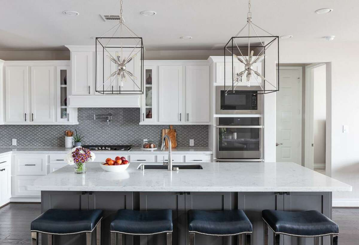 Oversized chandelier/lanterns were hung over the island in the kitchen of Teresa Welch's Fulshear home.