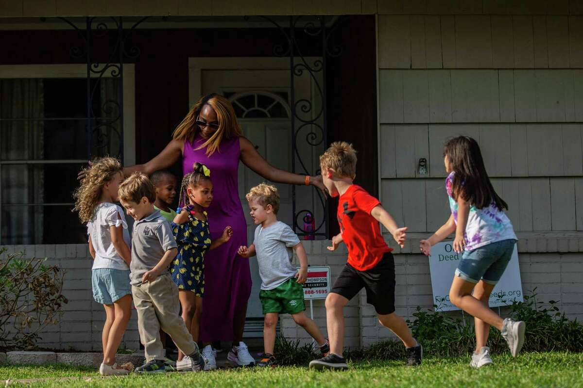 Ashley Jackson, 38, center, a resident of Oak Forest mobilizes the children from her neighborhood as they spend the afternoon together playing outside, Monday, April 12, 2021, in Houston.
