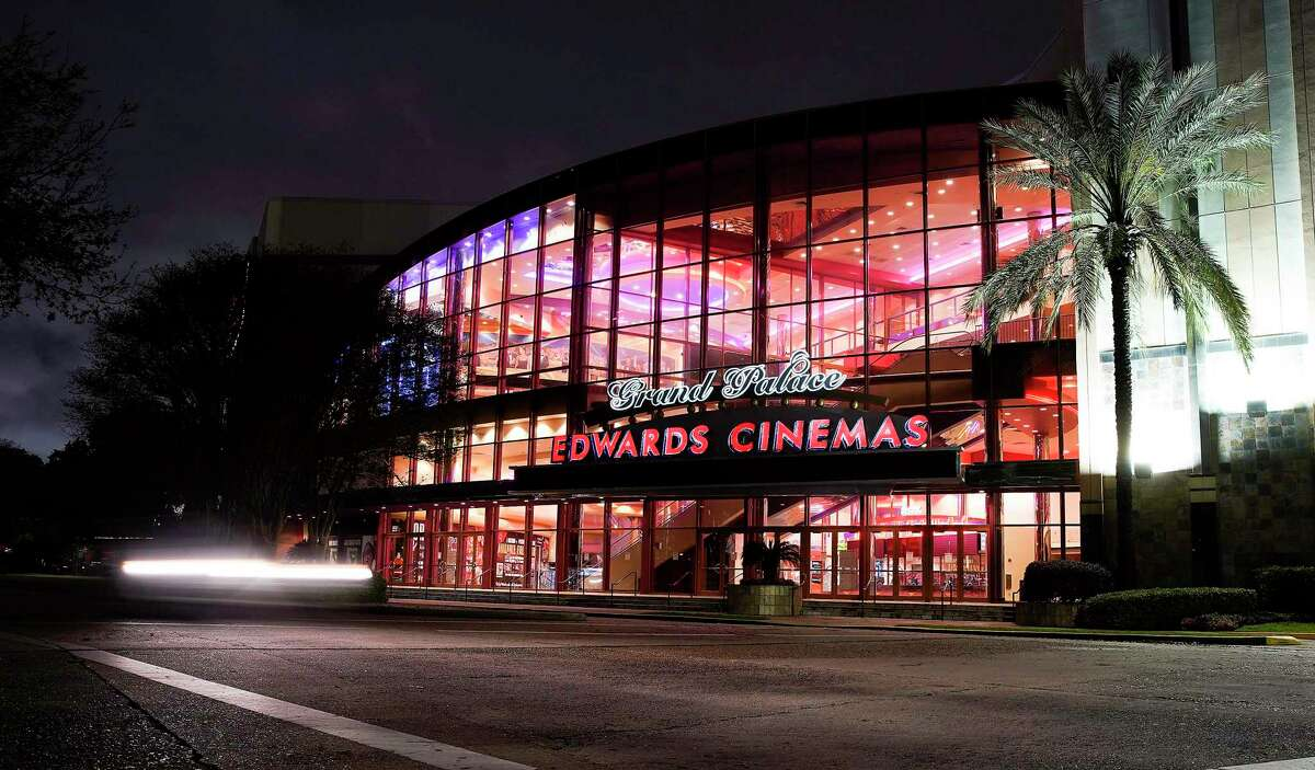 Edwards Cinemas keeps its lights on as it stays empty on a Friday night in Houston on March 20, 2020.