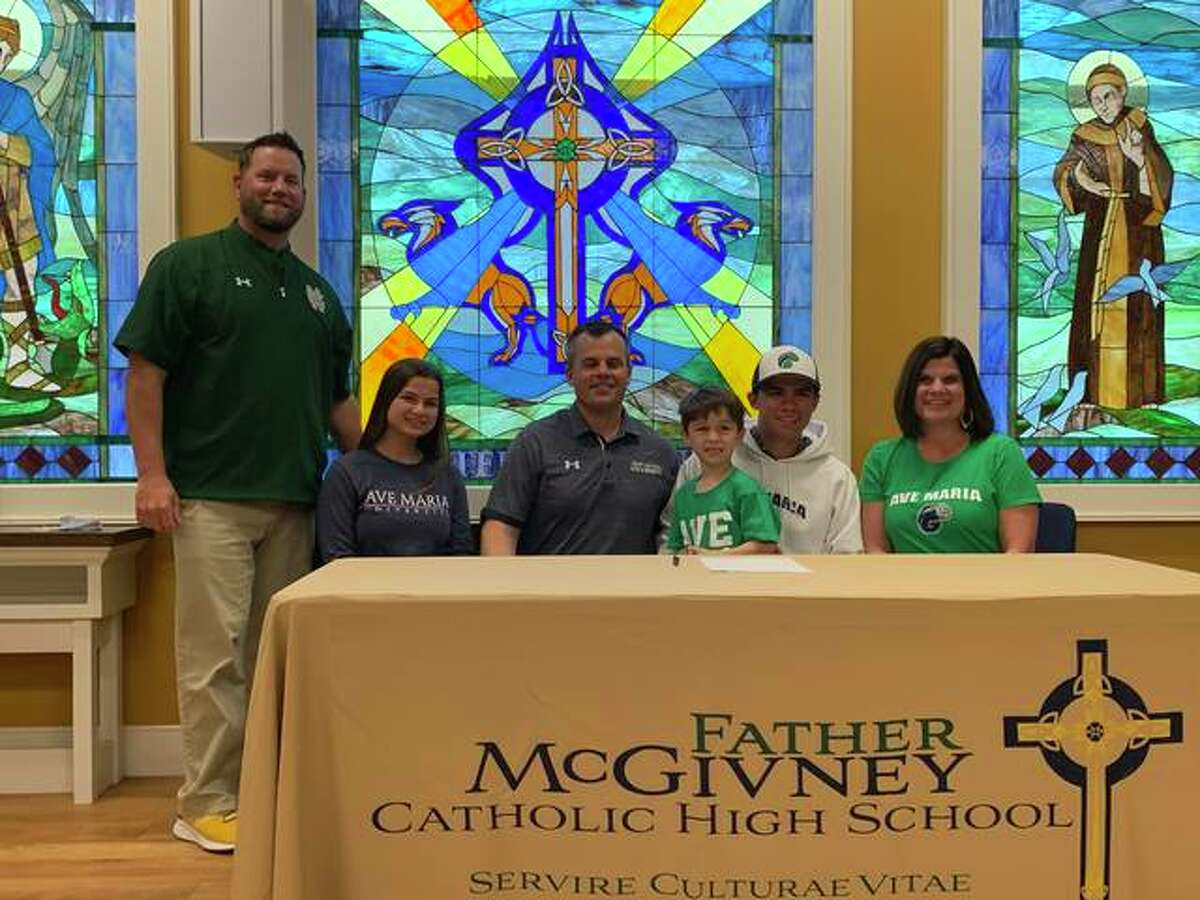 FMCHS senior Luke Deakos, seated second from right, will play college baseball for Ave Maria University in Florida. He is joined in the picture by his family and coach Steve Erwin.