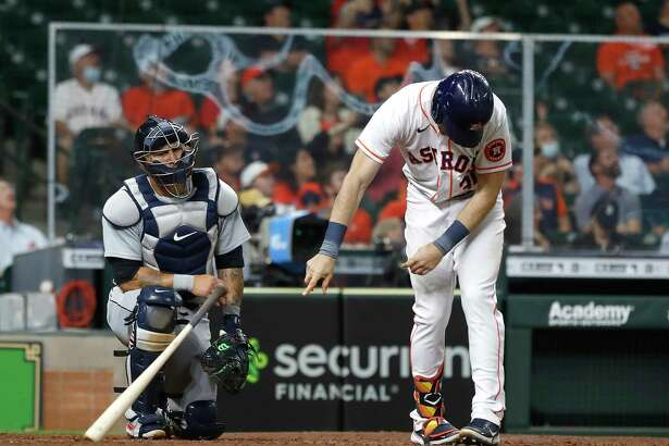 Houston Astros Kyle Tucker (30) throws his bat in frustration as he flied out during the sixth inning of an MLB baseball game at Minute Maid Park, in Houston, Wednesday, April 14, 2021.