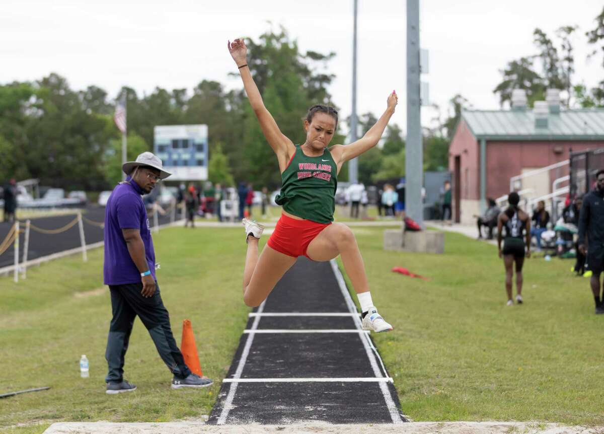 Kennedy Doakes of The Woodlands competes in a girls long jump during the District 13-14 Area Meet at College Park High School, Thursday, April 15, 2021, in The Woodlands. Doakes placed first during the meet.