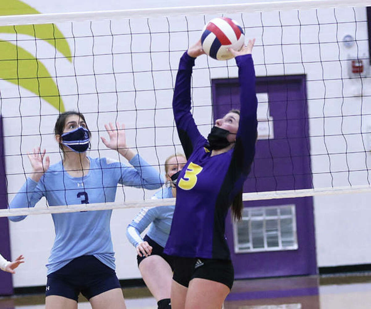 CM's Maddie Brueckner (3) sets in a match against Jersey earlier this season in Bethalto. Brueckner and the Eagles were in Alton on Thursday night and worked three sets to beat the Explorers at Marquette.