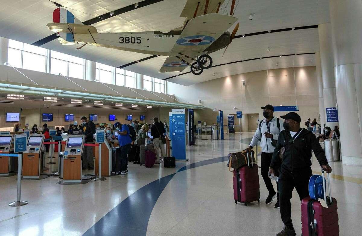 Passengers make their way through a San Antonio International Airport ticketing area in this April, 2021, file photo.