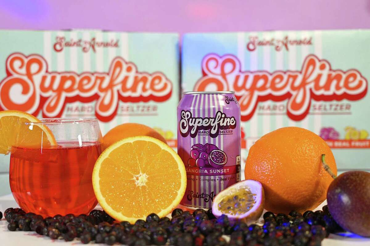 Saint Arnold Brewing's Superfine hard seltzer line includes Sangria Sunset, with black currant, passion fruit and orange peel.