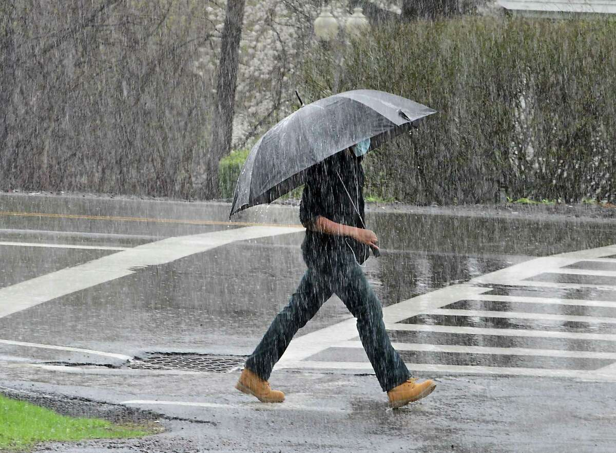 A pedestrian uses an umbrella to stay dry during a rainy Friday, April 16, 2021 in Loudonville, N.Y.(Lori Van Buren/Times Union)